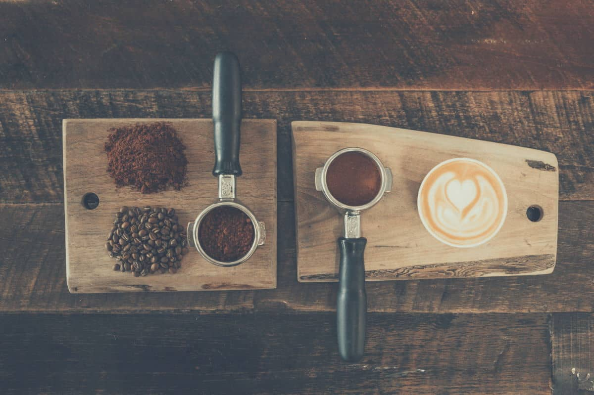 Birds eye view of espresso tampers on a serving board
