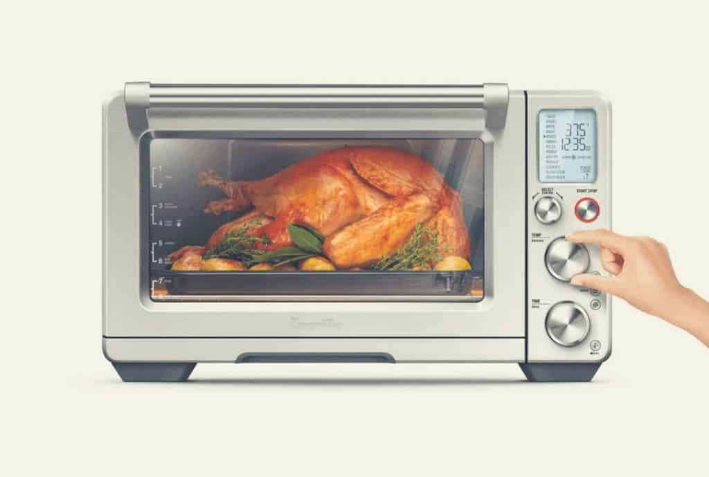 A chicken cooking inside a Breville BOV900BSS microwave oven