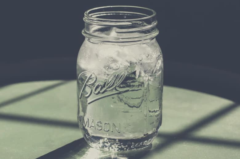 A bright picture of an empty mason jar