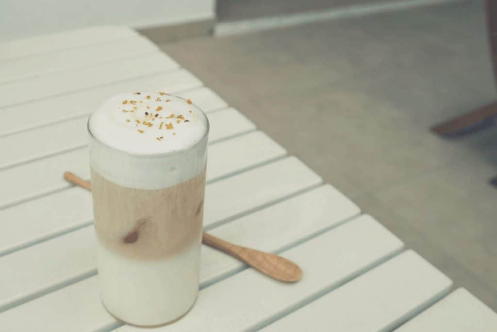 A picture of a multi layered latte on a table