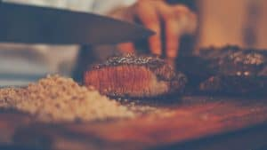rare steak being cut with a sharp knife