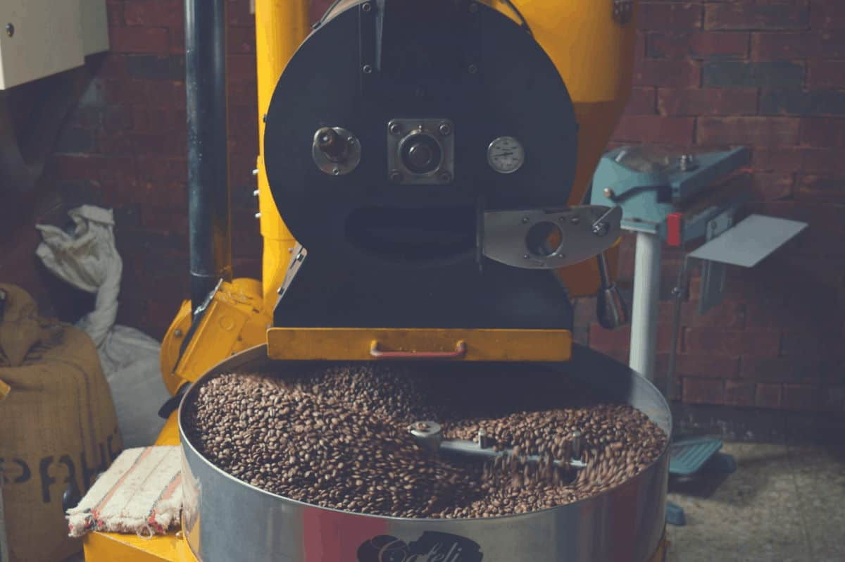 A wide shot of a coffee roasting machine