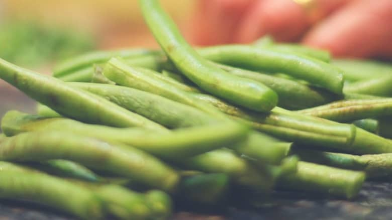 A pile of green beans ready to be sliced