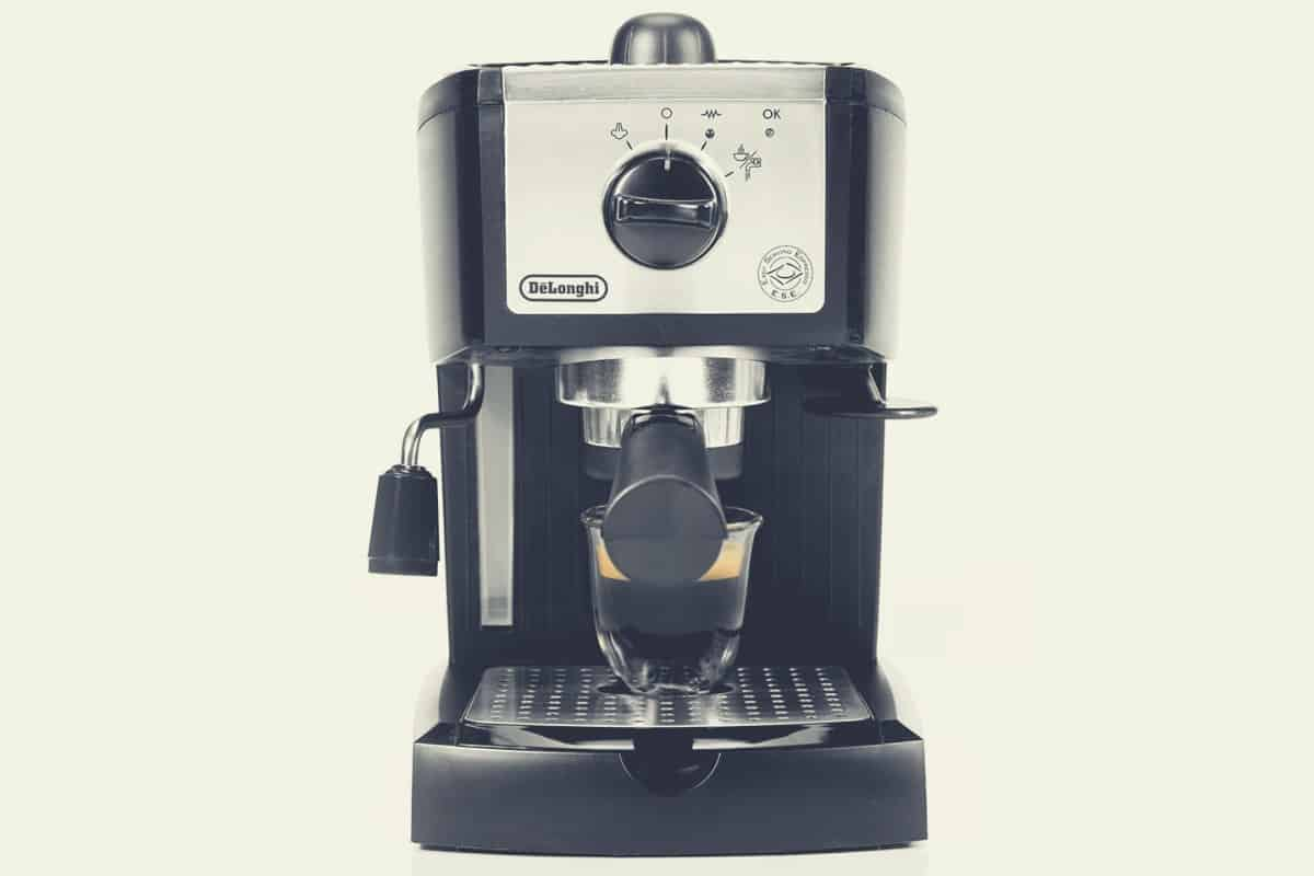 A wide shot of the Delonghi EC155 espresso, cappuccino and latte machine
