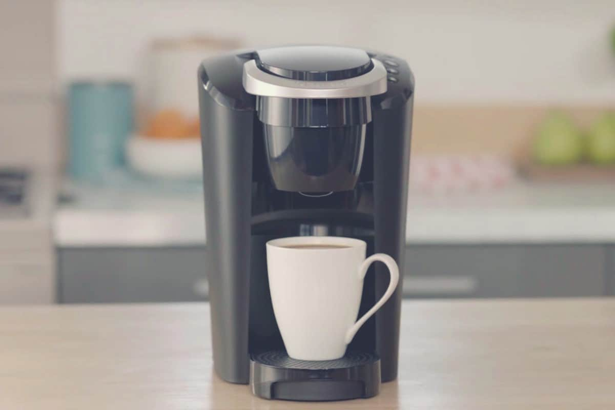 A full size shot of a Keurig K-Classic machine on a kitchen countertop