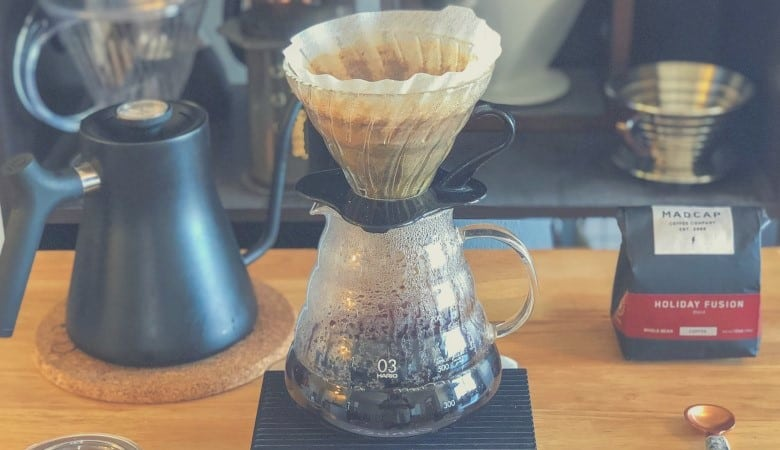 A manual pour over coffee device