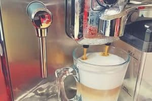 a close up shot of the Gaggia Accademia producing a cappuccino coffee