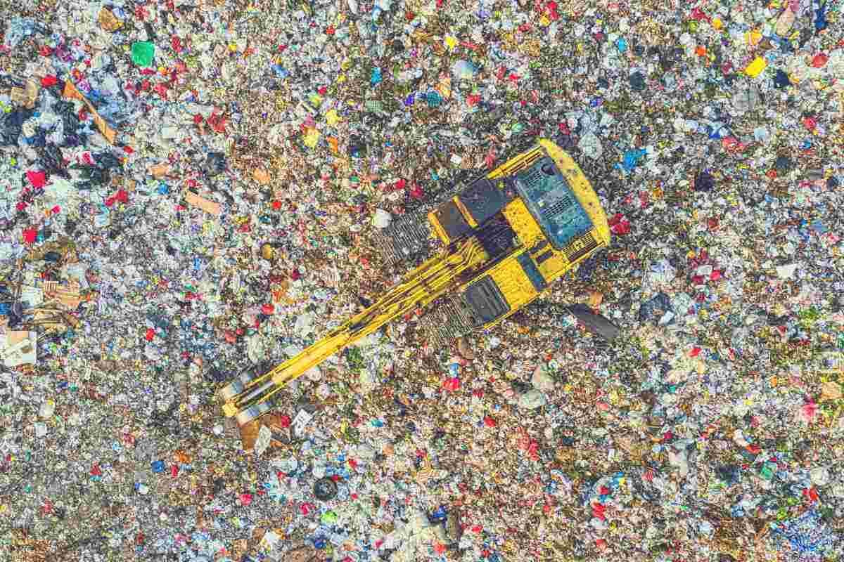 An overhead shot of a digger working at a landfill site