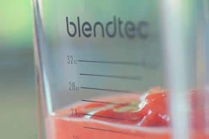 A close up of the blendtec classic container jar with strawberries inside
