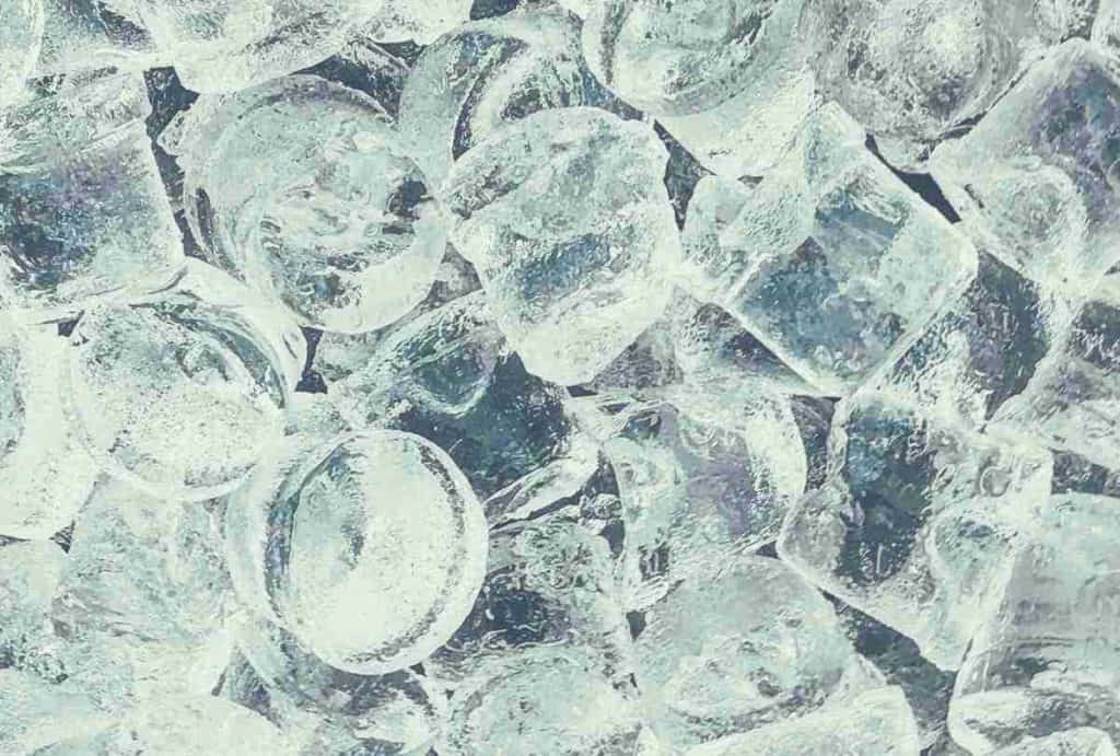 A close up shot of a pile of ice cubes