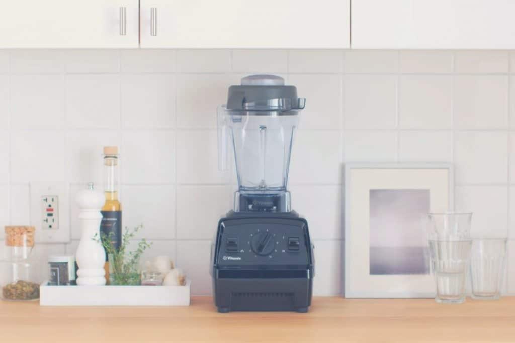 A Vitamix Explorian E310 blender on a kitchen countertop