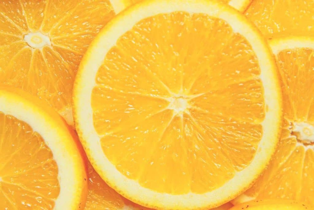 An extreme close up of a pile of sliced oranges