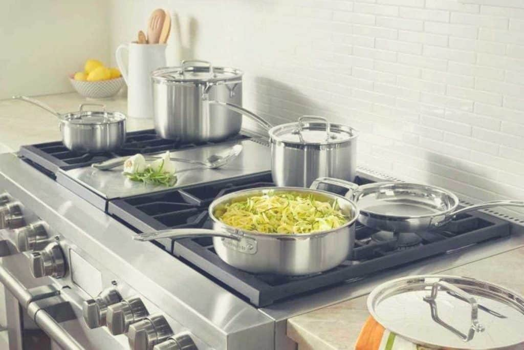 Most items of the Cuisinart MultiClad Pro 12 piece set on a kitchen stovetop